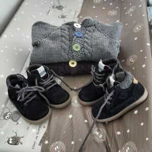 cardigan bimbo o bimba con trecce e bottoni colorati neonato